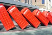 Traditional old style red phone boxes in London - domino effect — Stock Photo