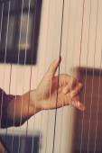 Closeup of a woman playing the harp — Stock Photo