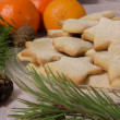 Biscuits in the form of stars, tangerines, pine branches and cones — Stock Photo #63809253