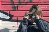 Young girl with camera in the city — Stock Photo