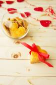 Cookies in the Shape of Heart at Day St Valentine on Wooden Back — Stockfoto