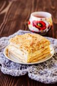 Millefeuille pastry with a cup of tea on wooden table — Stock Photo