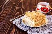 Millefeuille pastry in a plate on wooden table — Foto de Stock