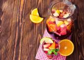 A jug of refreshing sangria with fruits on wooden background — Foto de Stock