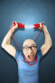 Man need energie holding red elettric wires — Stock Photo