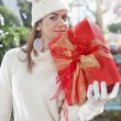 Girl in a Christmas shop with red gift box — Stock Photo #55393541