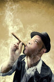 Man smoking a big cigar surrounded by smoke — Foto Stock