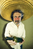 Crazy mexican man offering roomwhile smoking — Stock Photo