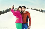 Couple making a selfie on the snow — Stock Photo