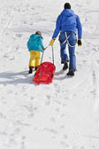 Father and son having fun in the snow — Stockfoto