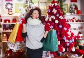 Happy girl thinks its purchases of Christmas — Stock Photo