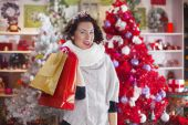 Woman with shopping bags in a store Christmas — Stok fotoğraf