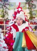Crazy woman with her credit card and christmas gifts — Stok fotoğraf