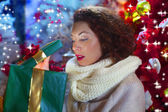 Curious woman opens Christmas gift — Stock Photo