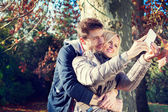 Couple taking selfie in autumn — Stock Photo