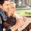 Couple in love gets a Selfie while drinking aperitif — Stock Photo #60529779