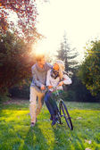 Man and woman on a bicycle — Stock Photo