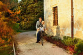 Couple having fun on the bicycle — Stock Photo