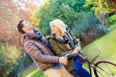 Autumn. couple cycling in park — Stock Photo