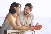 Couple having a spritz time with a lake view — Stock Photo
