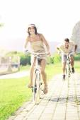 Couple in love have a ride with bicycles in the nature — Stockfoto