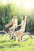 Couple having a bicycles ride into the nature — Stock Photo