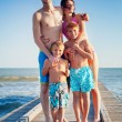 Happy Family Standing on Wooden Pier — Stock Photo #62062073