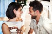Couple in love jokes at the restaurant by the lake — Stock Photo