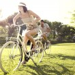 Couple having fun by bike on holiday to the lake in Italy — Stock Photo #62240107