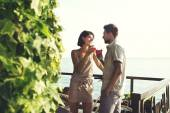 Couple in love having spritz time with lake view — Stock Photo
