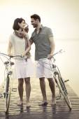 Couple in love pushing bicycle together — Stock Photo