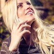 Attractive blond woman chatting on her mobile — Stock Photo #62387839