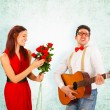 Romantic Man Singing with Guitar to Girlfriend — Stock Photo #62654607