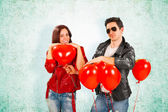 Rock Star Man Giving Heart Balloons to Girlfriend — Stockfoto