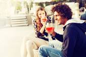 Couple Enjoying Cocktails and Laughing on Patio — Stock Photo