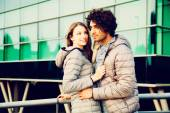Sweet Young Couple in Jacket in Front a Building — Стоковое фото