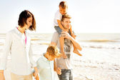 Family enjoyed walking on the beach at the sea — Stock Photo