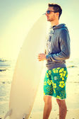 Pensive surfer  waiting for the perfect wave on the beach — Stock Photo