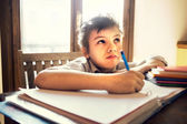 A young boy stressed on homework — Stock Photo