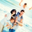 Family having walking on the beach to the sea — Stock Photo #65151507