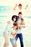 Happy Small Family Having a Vacation at the Beach During Summer. — Stock Photo