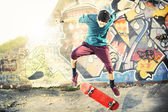 Skater in movement making a trick with his skate — Stock Photo