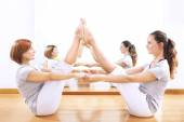 Women finding body balance throw a phisical exercise — Foto Stock