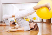 Women making fitness exercises with ball — Stock Photo