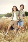 Young boys having fun in the wheat field — Stock Photo