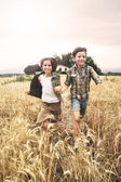 Young boys  running in the wheat field — Stock Photo