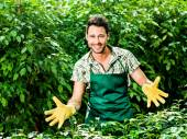 Farmer with open arms available to start his work — Stock Photo