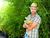 Farmer posing for a photo with his work gloves — Stock Photo