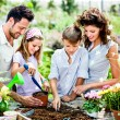 Family have fun in the work  of gardening — Stock Photo #65868133