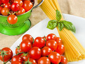 Composition of pasta spaghetti tomatoes and basil — Stock Photo